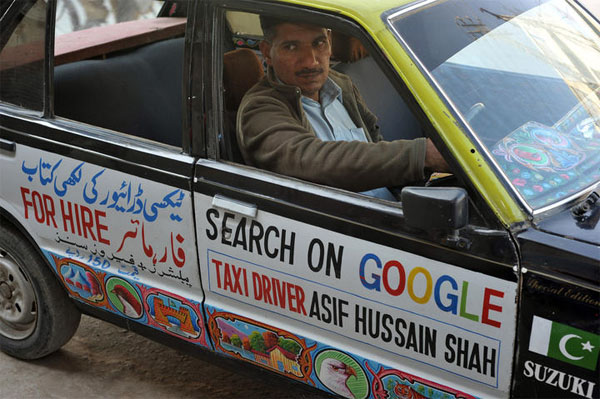 Asif hussain Shah the book writer in his taxi